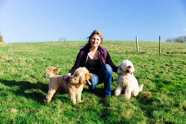 Anne Wood CEO with her dogs